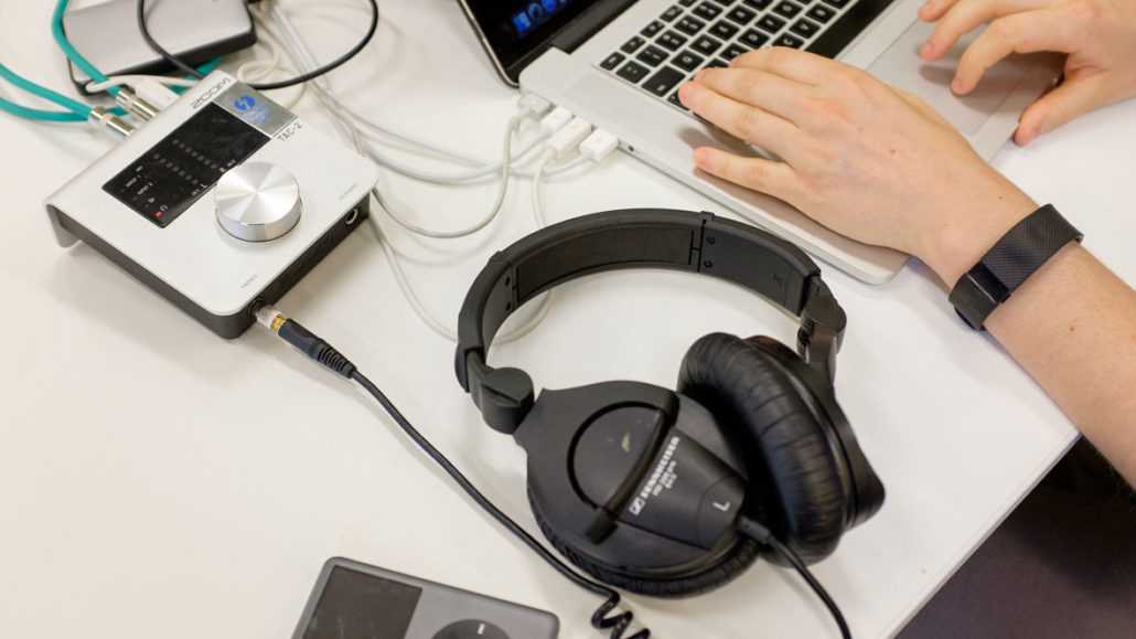Photograph of tools used to edit Outpatient Radio: Laptop, Headphones, iPod, Sound Mixer